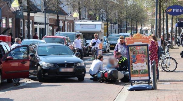 Snorfietser met hoofdwond na botsing.