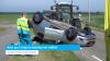 Auto op z'n kop na botsing met trekker (video)