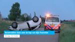 Automobilist slaat over de kop van dijk Poortvliet